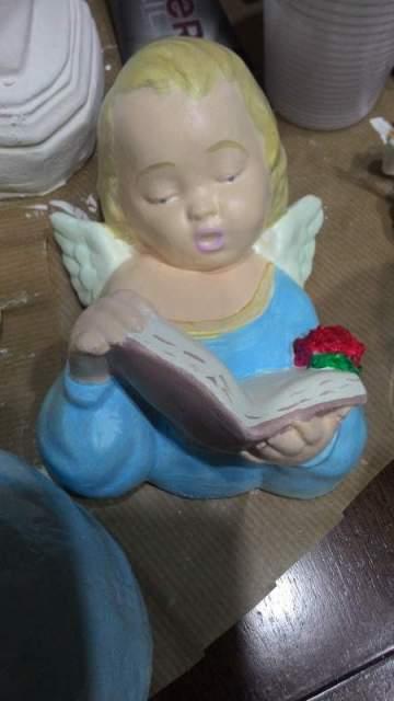 Bambino Angelo con libro